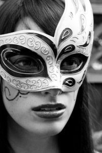The Enigma of the Striking,  Masked Woman in Black