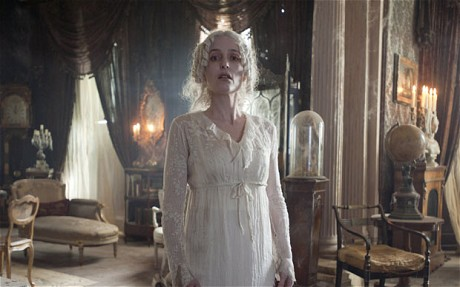 Miss Havisham - a once, beautiful and happy bride standing in a dilapidated house.