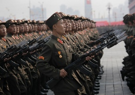 North Korea Succession (1945 - present day)  North Korean soldiers march during a massive military parade marking the 65th anniversary of the communist nation's ruling Workers' Party in Pyongyang, North Korea on Sunday, Oct. 10, 2010. This year's celebration comes less than two weeks after Kim Jong Il's re-election to the party's top post and the news that his 20-something son would succeed his father and grandfather as leader.