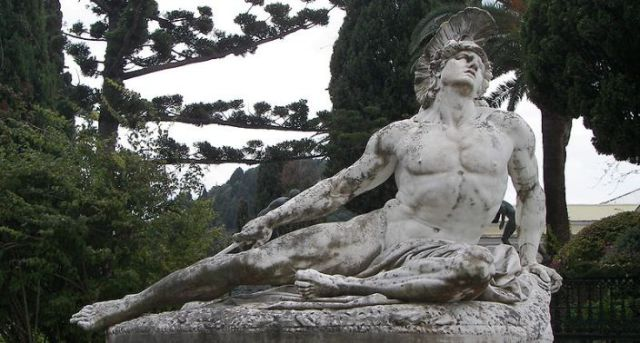 Located at a garden at the 19th century palace, Achilleon, on the Greek Island of Corfu. This statue depicts Achilles dying as he tries to remove the arrow embedded in his tendon. (Photo Credit: History By Zim - Beyond the Textbooks)