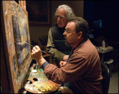 Thomas Kinkade learns the finer points of painting from Glen Wesman.