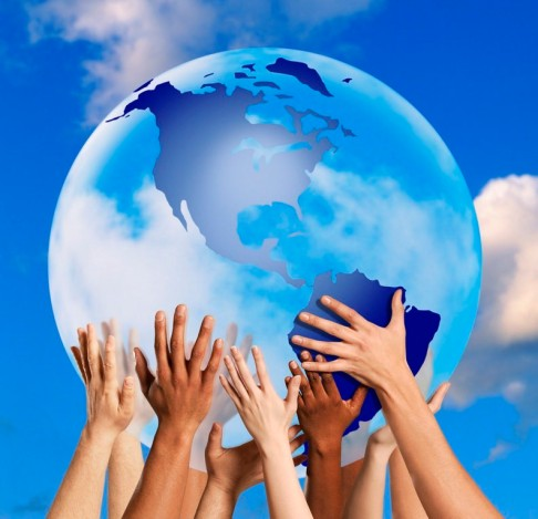 In Unity lies Strength. Long Live Unity! (Hands touching a globe --- Image by © Royalty-Free/Corbis)